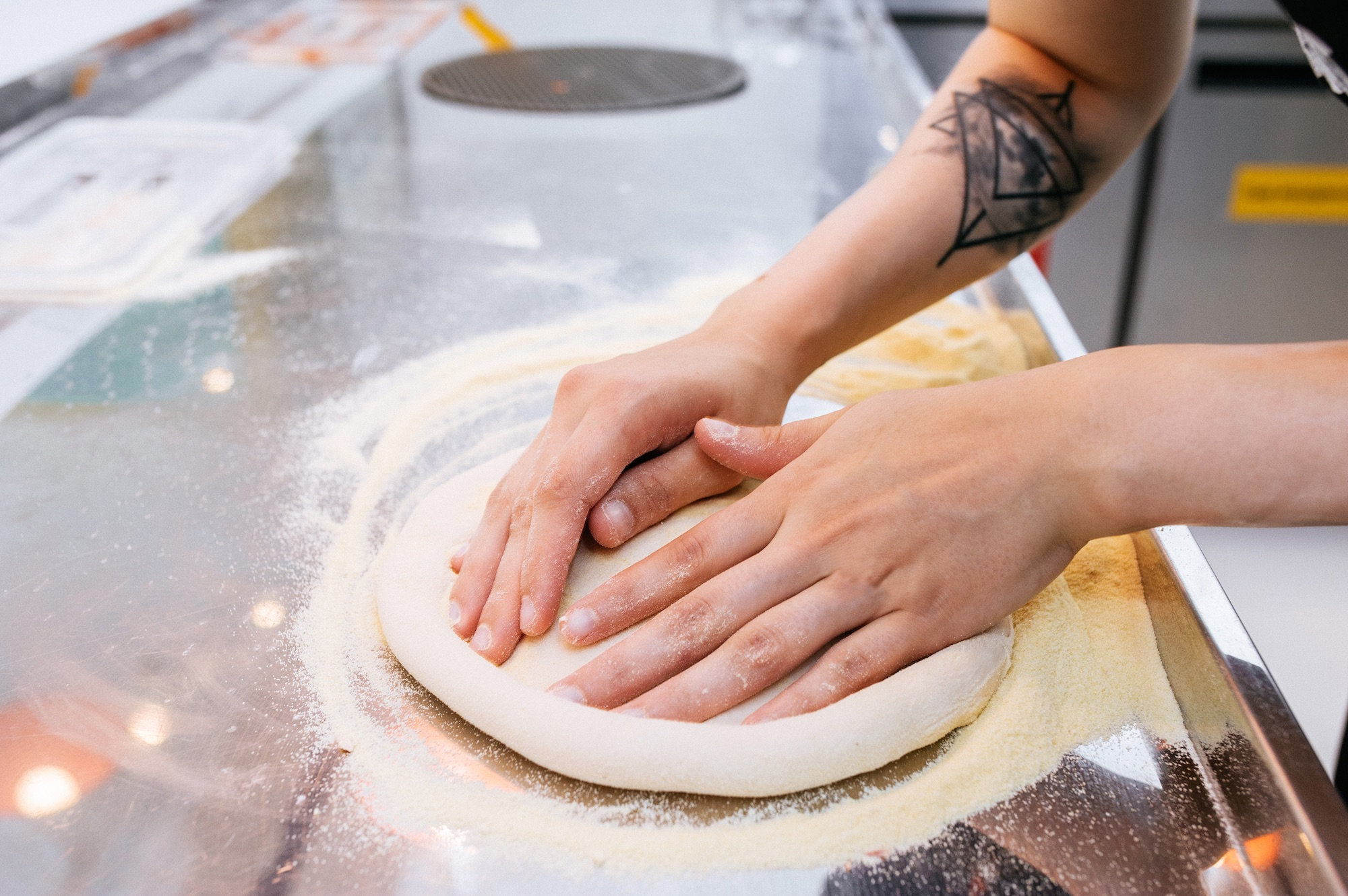 Why do we make pizza without gloves at Dodo Pizza?